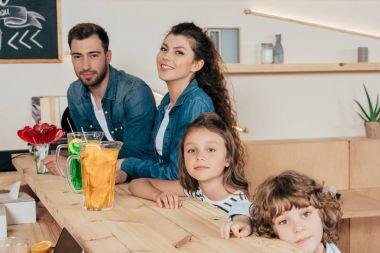 young family at bar counter