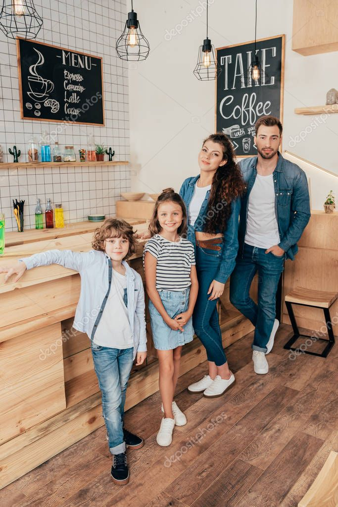 happy young family in cafe