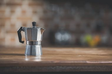 Coffee pot on wooden table in kitchen
