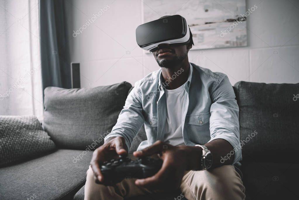 African american man using virtual reality headset