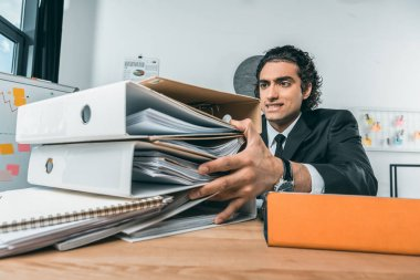 Businessman doing paperwork at workplace