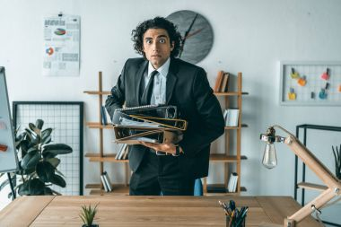 businessman with folders at workplace