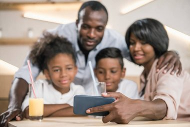 african-american family looking at phone