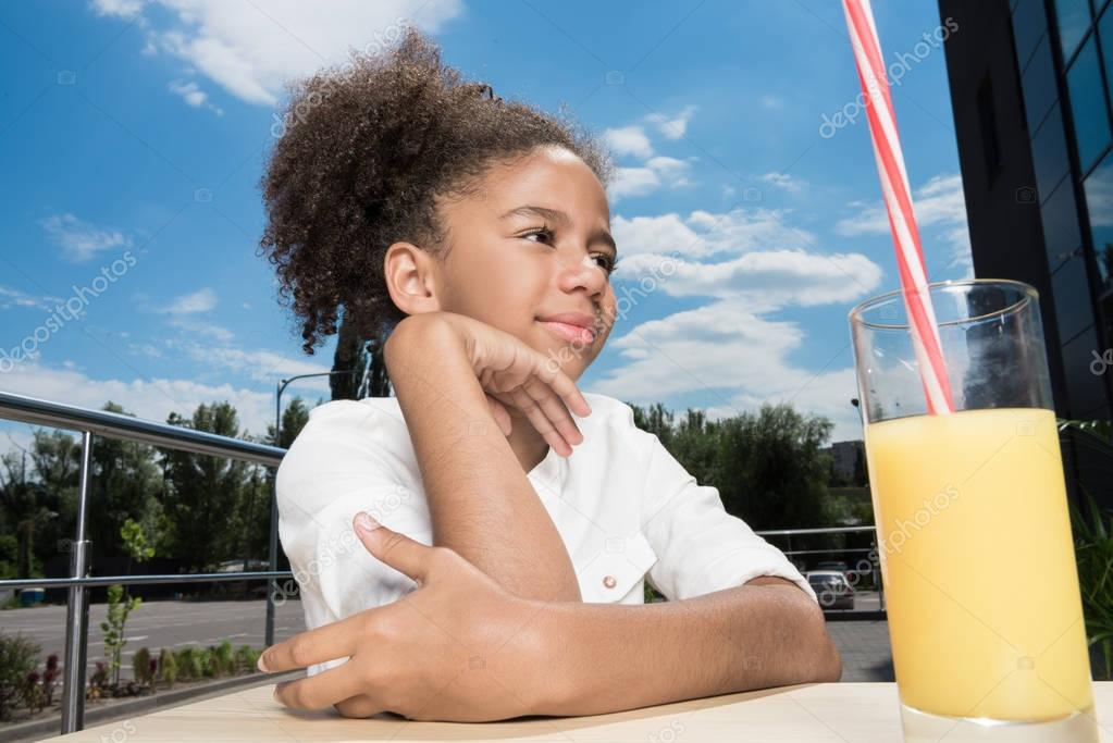 afro girl with orange juice