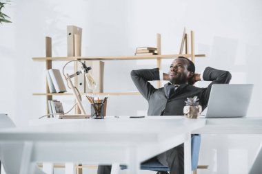 Relaxed young afro businessman