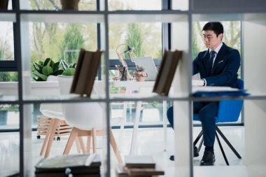 serious young asian businessman