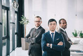 Fotografie multiethic businessmen with folded arms