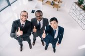 Fotografie businessmen showing thumbs up