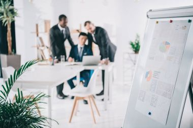 businessmen looking at laptop screen