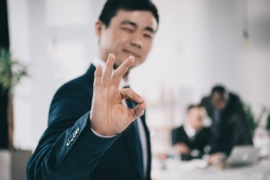 asian businessman showing okay sign