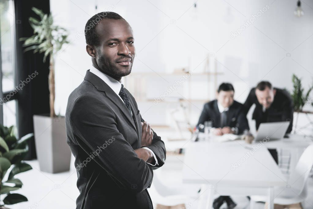 african-american businessman with folded arms