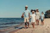 Fotografie african american family walking on beach
