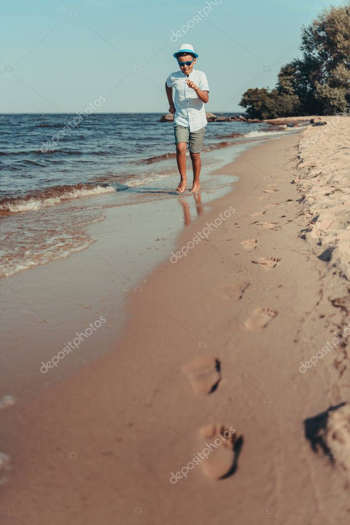 african american child running on beach