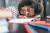 Fotografie Little girl writing in notebook