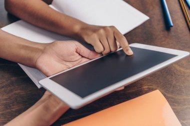 Female hands holding digital tablet