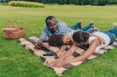 African american family having picnic