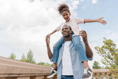 african american father and daughter in park