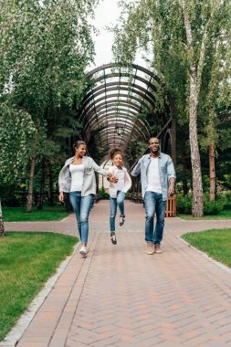 African american family walking in park