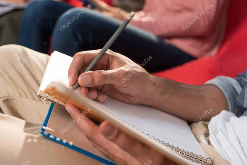 student with copybook and book