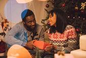 happy african american couple on christmas