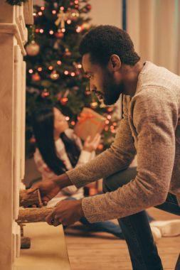multiethnic couple celebrating christmas