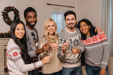 multicultural friends with champagne celebrating christmas