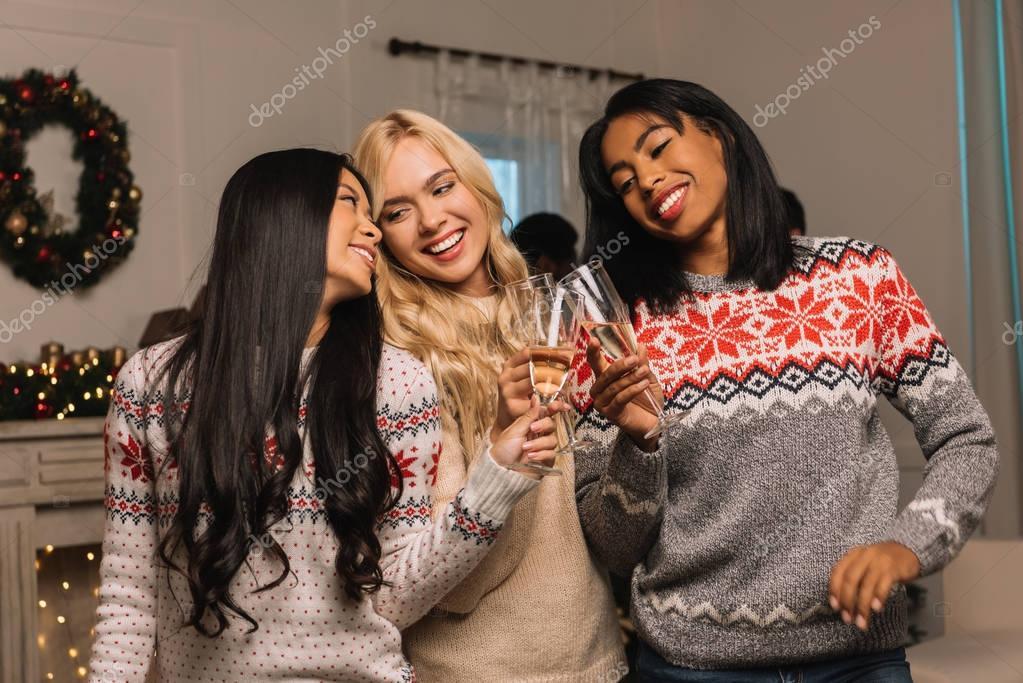 multiethnic women drinking champagne