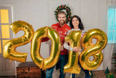 Photo couple with new year balloons