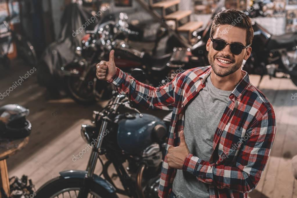 motorcyclist with thumbs up