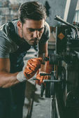 Photo mechanic working in repair shop