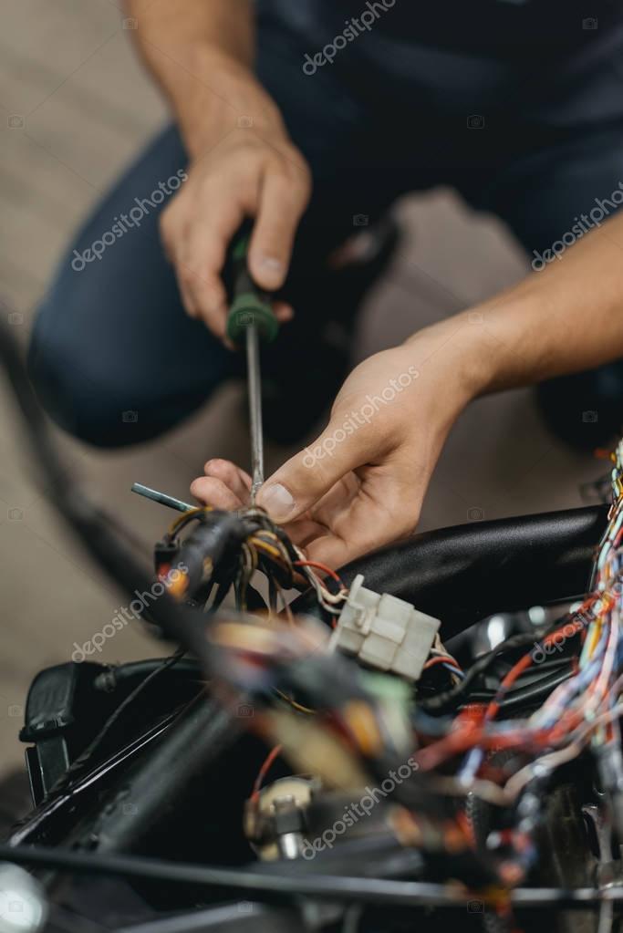 repairing motorcycle in workshop