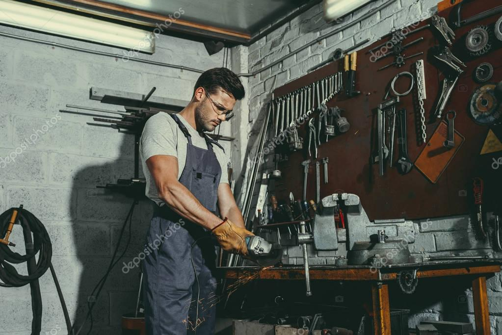 mechanic with tools in workshop