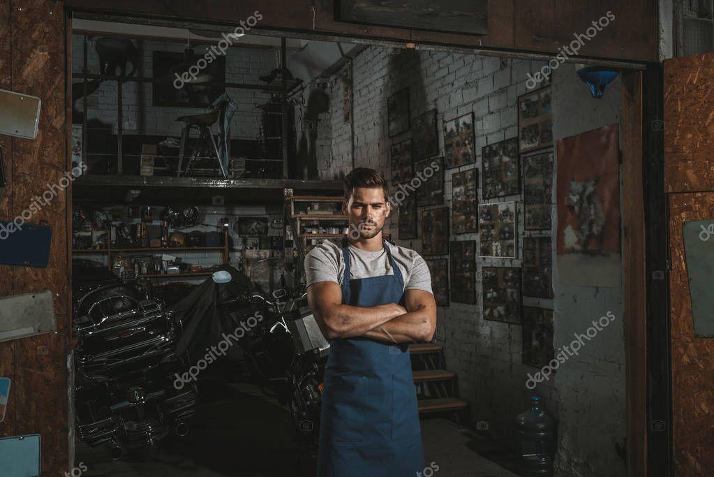 confident mechanic in repair shop
