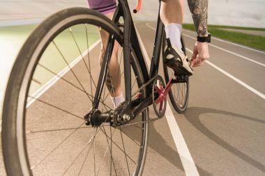 cyclist tying shoe