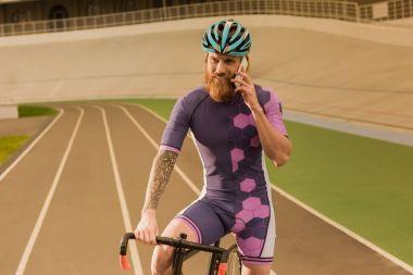 cyclist talking on smartphone