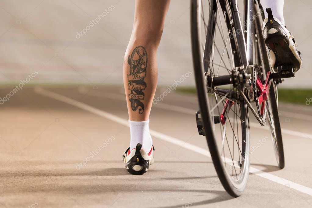 cyclist standing near bicycle