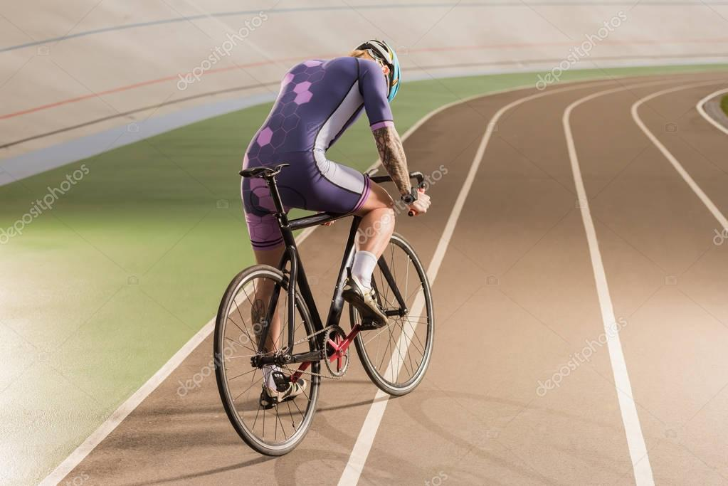 cyclist riding bicycle on cycle race track