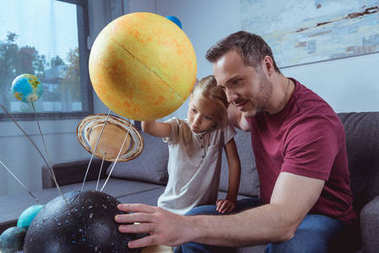 Father showing daughter planets