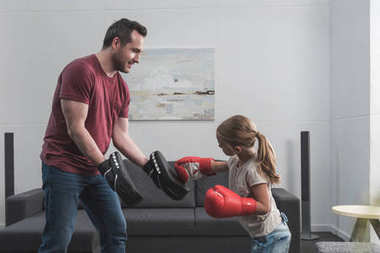 preschooler child learning boxing with father