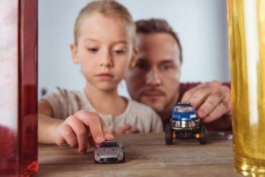 daughter and father playing car toys