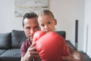 Father showing daughter how to boxing