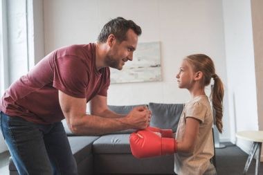 Father teaching daughter boxing