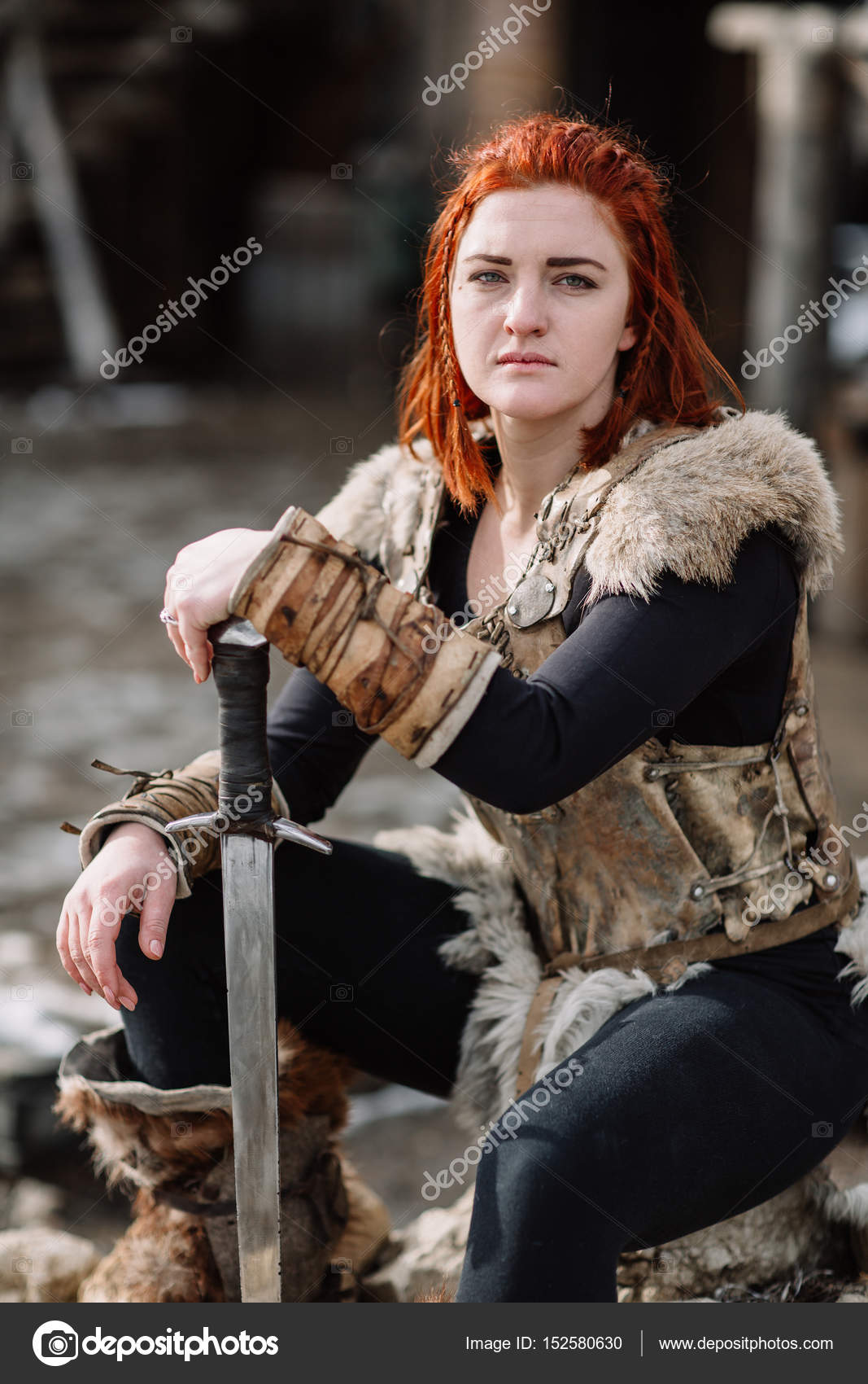 Portrait of a girl in a Viking outfit, red hair. ⬇ Stock Photo, Image by © Boykovi #152580630