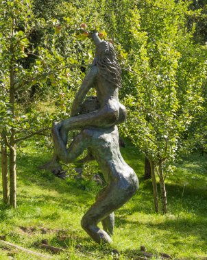 Adam and Eve in the garden of lovers at the Botanical Gardens of Trauttmansdorff Castle in Meran, South Tyrol, Italy
