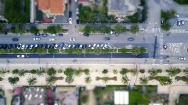 Traffic on the promenade road aerial shot with a drone. People going to the beach