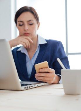 Businesswoman reading sms