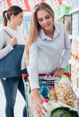 Girls shopping at supermarket