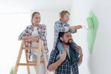Happy family renovating new home