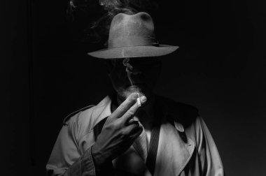 man smoking cigarette in dark