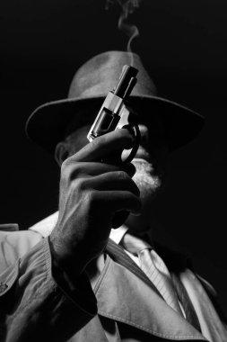 detective posing in dark